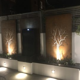 Corten bespoke design panels at night- wall art - decori
